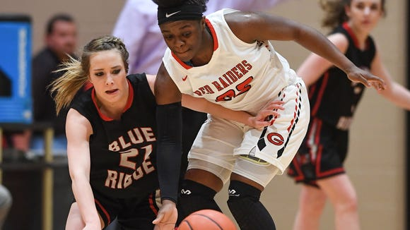 Blue Ridge's Abby King (21), left, and Greenville's Madisen Smith (22) scramble for a loose ball during the first round of the Girls AAAA playoffs on Tuesday, February 13, 2018 at Greenville High.