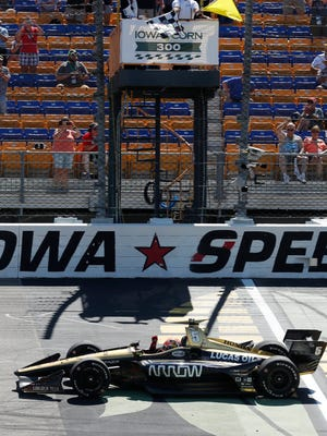 James Hinchcliffe (5) crosses the finish line as he wins the IndyCar Series auto race Sunday, July 8, 2018, at Iowa Speedway in Newton, Iowa.