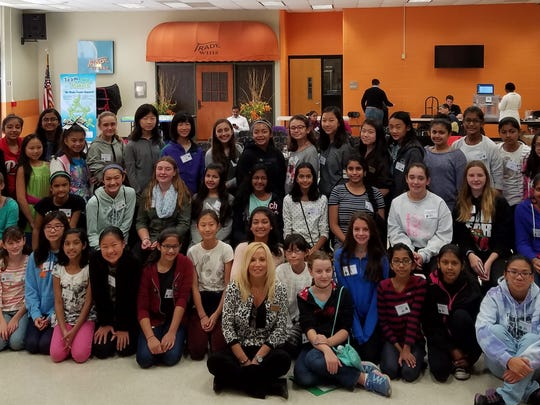 Freeholder Director Pat Walsh, standing at right, and Somerset County Commission on the Status of Women Chair Janice Fields, seated center front, are pictured with girls who participated in the commission-sponsored STEM program at the Vo-Tech High School in Bridgewater.