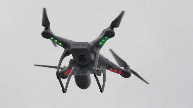 The FAA is drafting rules for drones to share the skies with passenger planes.