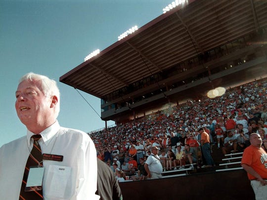 In this 1999 photo, Paul Risser watches an Oregon State football game from the sideline in Corvallis, Ore. Oregon State University says Risser, who served as the school's 13th president, from 1996 to 2002, has died at age 74. Risser died Thursday, July 10, 2014, in Norman, Okla.  (AP Photo/The Oregonian, Ross William Hamilton)