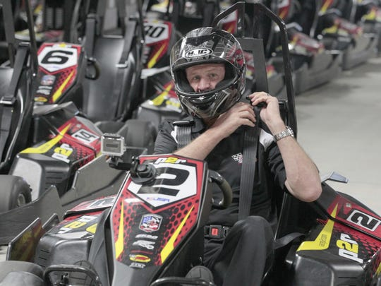 NASCAR legend Rusty Wallace straps into his No. 2 car for a pair of racing sessions at Pole Position Raceway in Marketplace Mall on Wednesday.