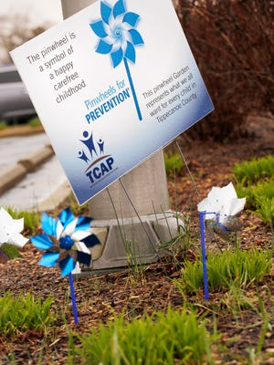 Blue and silver pinwheels were placed outside West Lafayette Police headquarters during child abuse prevention month in April.