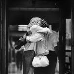 Julie Scherer, left, is hugged by a friend, Kim Hoyt, at the emergency room of Humana Hospital-University in Louisville, Ky. Scherer's father was one of those injured in the Standard Gravure mass shooting. Mike Hayman/Louisville Courier-Journal . Sept. 14, 1989
