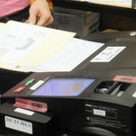 A ballot is fed into an electronic voting machine. New York will have three separate primary elections this year.