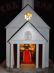 This church was the first piece made by Lester Alvis, Jr. of Jackson of the 19-piece Christmas Village, which he and his late wife, Minnie, shared with thousands of visitors through the years on the lawn of their northeast Jackson home during the Christmas season.