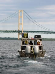 Oil pipeline operator Enbridge tows an autonimous underwater veehicle into the Straits of Mackinac to conducting tests on its dual lines under the Straits of Mackinac in this Thursday, June 9, 2016 file photo. Enbridge Energy will pay more than $1.86 million for alleged delays last year in pipeline inspections, including parts of the Line 5 pipeline in Michigan.