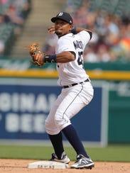 Detroit Tigers second baseman Dixon Machado throws