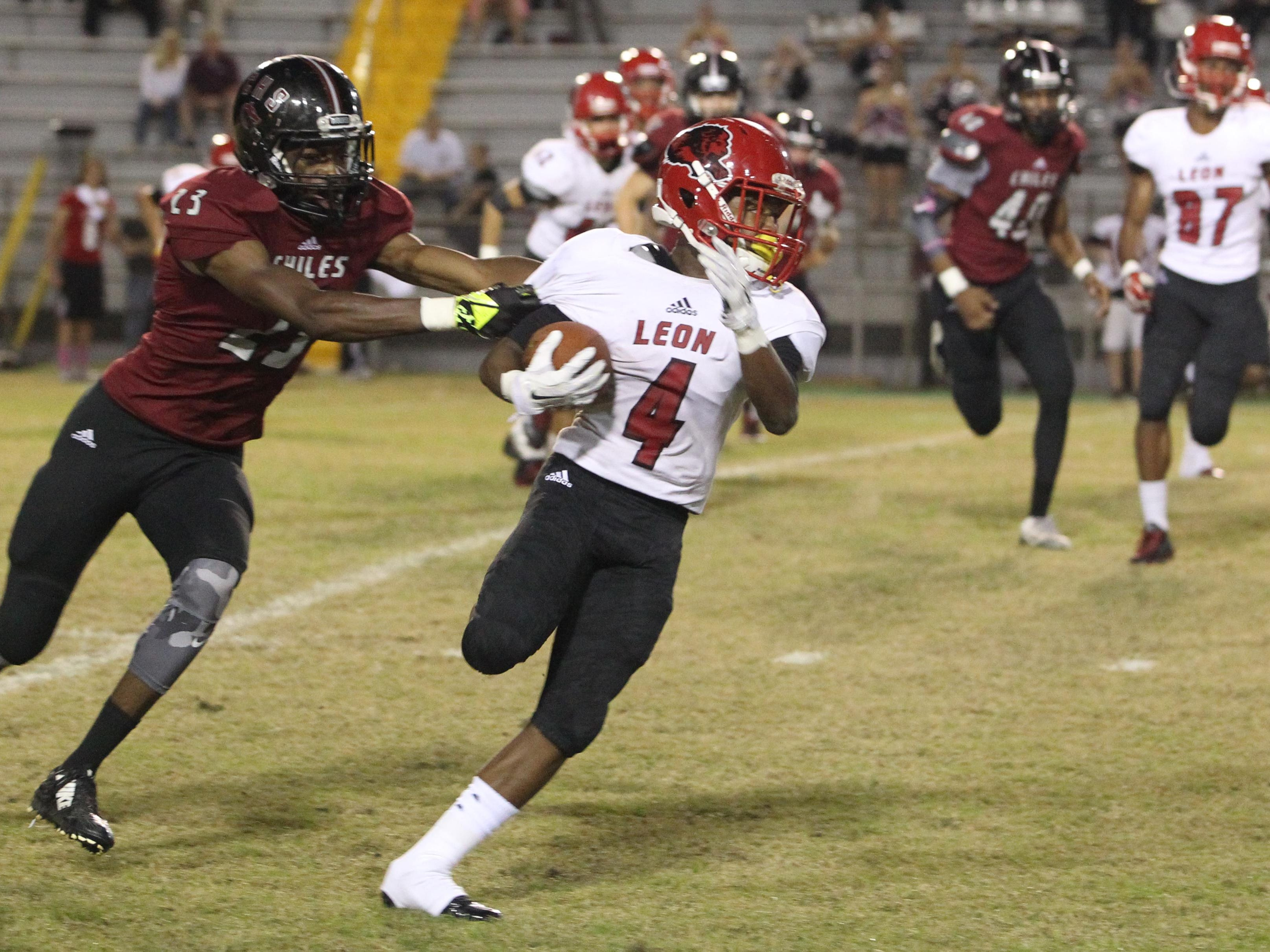 Leon's Darquez Brutton runs away from Chiles' Drake Frison on a kickoff return. Leon won 22-21 over Chiles at Gene Cox Stadium, forcing a three-way tie in District 2-7A.