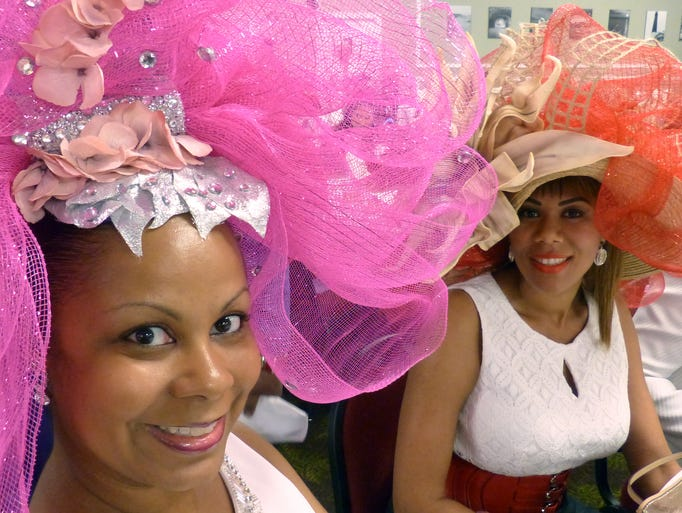 """(l-r)  Jill Mills and Tia Rogers both wowed the crowd and impressed judges with their hats Sunday afternoon during the 14th annual Scholarship """"It's All About Pizzazz!!!"""" Hat Show and Luncheon put on by the Pensacola Chapter of the National Coalition of 100 Black Women, Inc. .  The event was held at New World Landing."""