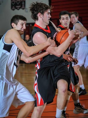Hunterdon Central's Cole MacKnight (right) and Bridgewater-Raritan's Tony Colarusso battle for the loose ball during their game on Dec. 22, 2015 in Bridgewater.