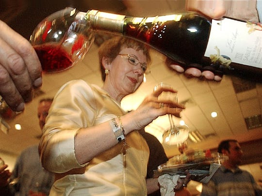 Mary Hert samples at a past Wine Fest.