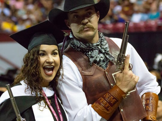 Kassi Simpson poses for a photograph with Pistol Pete on Saturday, May 12, 2018 at the Pan American Center during the 2018 commencement ceremony.