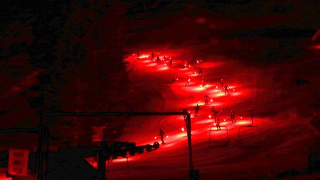 The torch light parade at Ski Apache creates a dramatic scene.