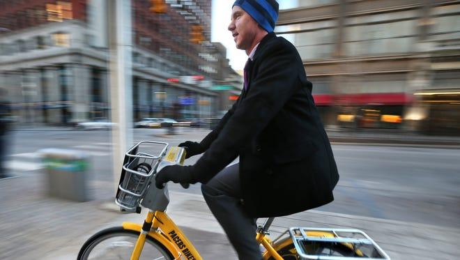 Garth Brazelton, 34, a Downtown office worker, is shown heading to his Massachusetts Avenue home after work on Jan. 27, 2015. Brazelton says he rides to and from work using the Pacers Bikeshare program, which costs him $80 for an annual pass.