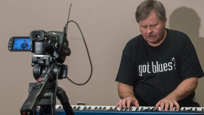 Tom Sellers performs some of his original songs while playing keyboard at the Montgomery Advertiser on Monday, Oct. 31, 2016.