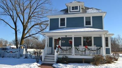 Exterior of the Victorian era home of Rick and Patti Koran featured in the 2013 Holiday Home Tour.