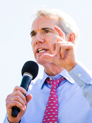 Sen. Rob Portman, R-Ohio, speaks at rally in Washington against cuts to workers' pensions.