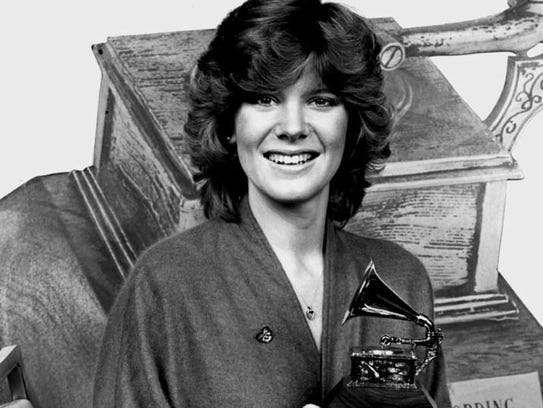 Debby Boone with her Grammy for the 1977 award for