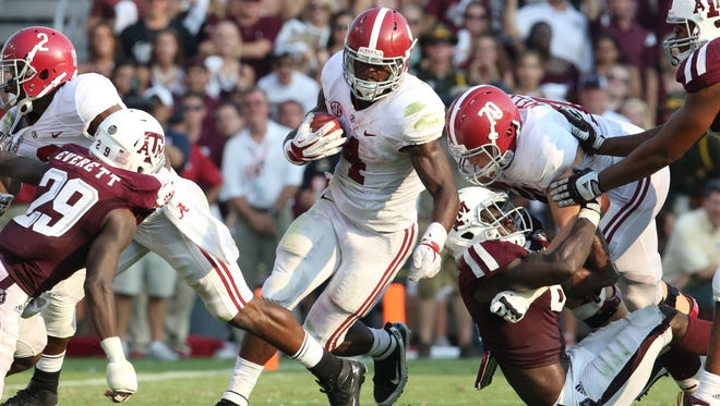 Alabama running back T.J. Yeldon carries against Texas A&M on Saturday in College Station, Texas.  USA TODAY Sports Sep 14, 2013; College Station, TX, USA; Alabama Crimson Tide running back T.J. Yeldon (4) runs with the ball in the fourth quarter against the Texas A&M Aggies at Kyle Field. Mandatory Credit: Matthew Emmons-USA TODAY Sports