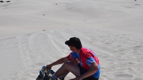 Zach Sturiale '17 takes a break from sandboarding in South Africa (Photo courtesy of Sturiale)