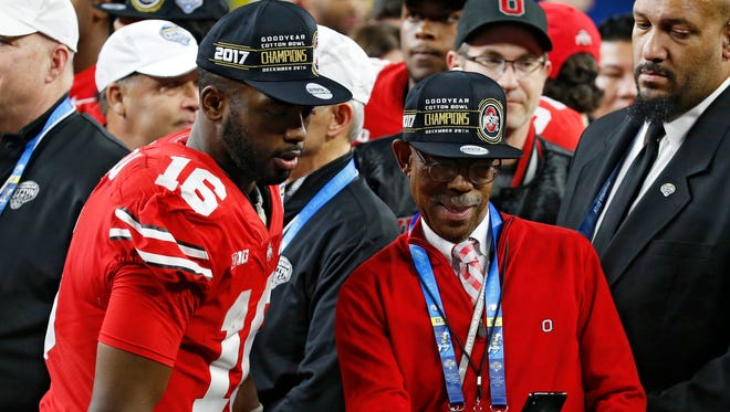 Ohio State quarterback J.T. Barrett poses for a picture with school president Michael Drake after the 24-7 Cotton Bowl victory over USC.