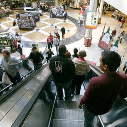 Shoppers ride the escalator to and from Center Court