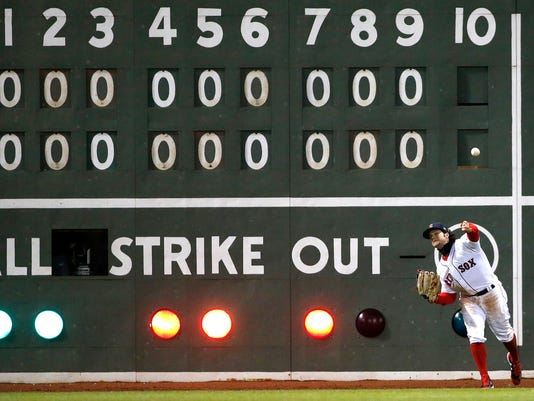 Boston Red Sox's Andrew Benintendi throws the ball in after a single to left field by Pittsburgh Pirates' Francisco Cervelli during the 10th inning of a baseball game in Boston, Wednesday, April 5, 2017. (AP Photo/Michael Dwyer)