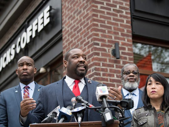 Philadelphia City Councilman, Kenyatta Johnson, center, flanked by two fellow members, speaks at the podium during a press conference outside the Starbucks on 18th & Spruce Streets in Philadelphia, Monday, April 16, 2018. Two black men were arrested last week in a video incident that went viral over the weekend.