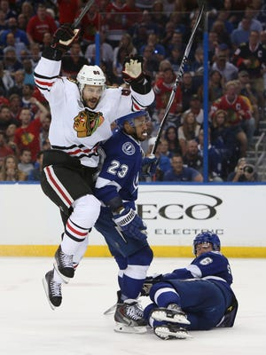 Chicago Blackhawks center Antoine Vermette (80) celebrates after scoring a goal against the Tampa Bay Lightning in the third period in game one of the 2015 Stanley Cup Final at Amalie Arena.