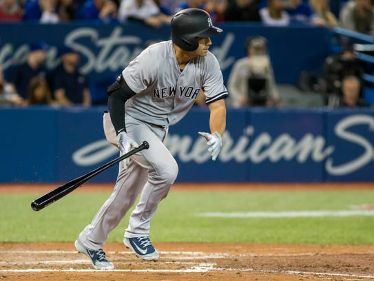 New York Yankees shortstop Tyler Wade (12) hits a double