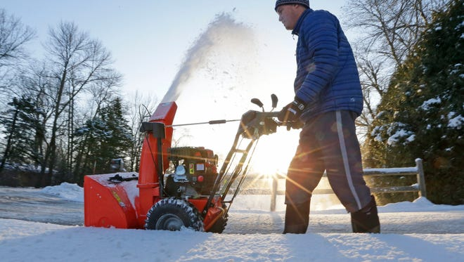 SNOW - Thomas McWilliam, of Bayside, snow blows his driveway on E. Brown Deer Rd. in Bayside on Thursday, April 19, 2018. Wednesday's storm dropped 3.2 inches of snow on Milwaukee and a record 7.2 inches on Madison, the National Weather Service at Sullivan said. The previous snowfall record for April 18 in Madison wasÊ3.4 inches in 1912.   -  Photo by Mike De Sisti / Milwaukee Journal Sentinel