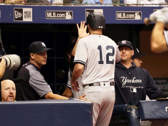 New York Yankees shortstop Tyler Wade (12) is congratulated as he scores a run during the fifth inning against the Tampa Bay Rays at Tropicana Field.