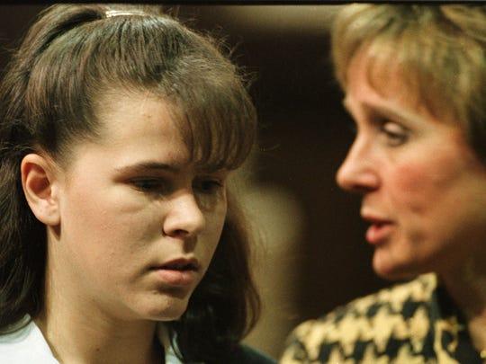 Prosecutor Melodee Hanes, right, escorts Jada Blewer