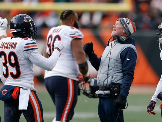 Chicago Bears head coach John Fox, center right, celebrates with free safety Eddie Jackson (39) in the second half of an NFL football game against the Cincinnati Bengals, Sunday, Dec. 10, 2017, in Cincinnati. (AP Photo/Gary Landers)