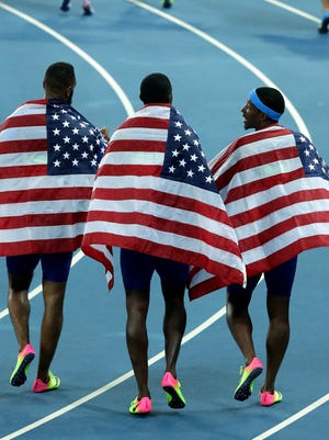 The USA 4x100 relay before the announcement of the DQ.