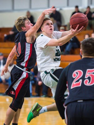 Rice Memorial's Elliott Nelson, right, drives to the hoop under pressure from Rutland's Matt Lorman in South Burlington  on Tuesday, January 3, 2017