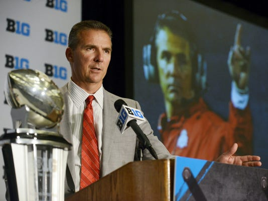 Ohio State head coach Urban Meyer speaks to the media during the Big Ten Football Media Day in Chicago last month. The Big Ten East is a beast, with Ohio State the popular pick to return to the College Football Playoff to defend its national title .