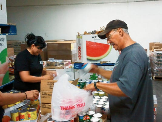 Harry Burns, a Farmington man who passed away on Friday, is seen bagging food at ECHO Food Bank in Farmington.