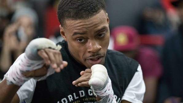Errol Spence Jr. warms up during a work out at Gleason's Gym, Wednesday, Jan. 17, 2018, in the Brooklyn borough of New York. Spence is slated to defend his IBF welterweight title against Lamont Peterson on Saturday in Brooklyn.(AP Photo/Mary Altaffer)