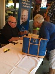 Kenney Shields talks to a fan Aug. 3.
