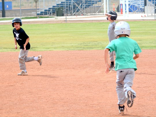 The Cavemen baseball camp works on baserunning Tuesday at Bob Forrest Youth Sports Complex.