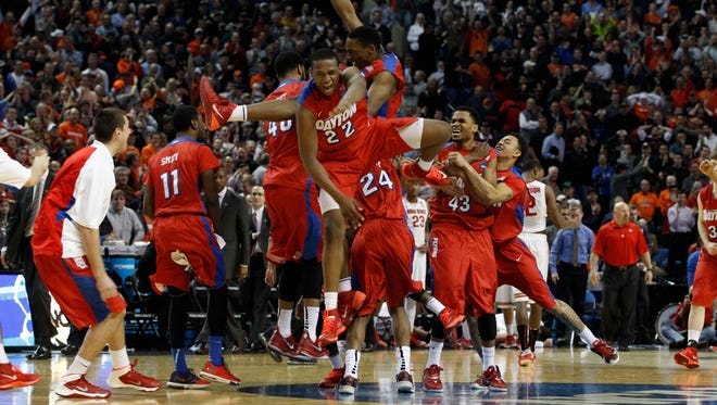 The Dayton Flyers celebrate after knocking off the Ohio State Buckeyes on Thursday in Buffalo.