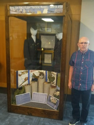 On his trip to Maxwell to see where his father received flight training during World War II as a Royal Air Force flight cadet, Edwin Norton, of Norton Fitzwarren, England, stopped at the exhibit in Air War College dedicated to the RAF Arnold Program flight cadets. The exhibit recognizes those RAF cadets who trained at Maxwell Field and Gunter Field during the war and the 79 RAF cadets who died from training accidents and were buried in Oakwood Cemetery, Montgomery.