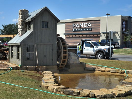Wichita Falls Parks Department employees worked to put the finishing touches on a new ornamental water feature near the intersection of Lawrence Road and Maplewood Avenue Thursday afternoon.