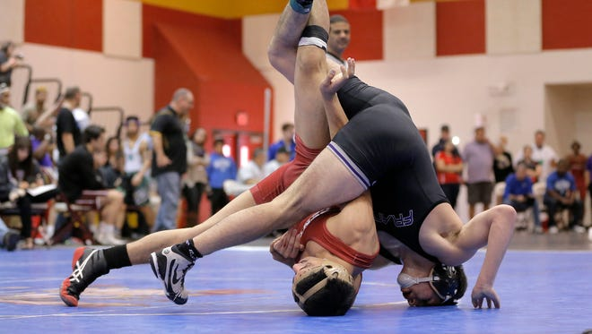 Franklin High School's Luke Martinez tangles up with Keller Central's Omar Ali-soub in their 138-pound match Friday at the 2016 Region 1-6A Wrestling Meet at El Dorado High School. Franklin's Martinez went on to win the match.