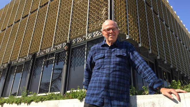 Southfield Mayor Kenson Siver stands this week in front of the vacant Reynolds Aluminum office on Northwestern Hwy. -- a 1960 design built in the heyday of Mid-Century Modern architecture. Siver will lead a tour Sunday of offices and homes in the style..