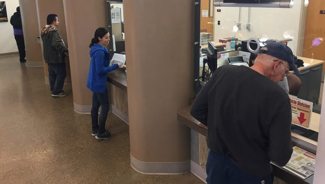 """Teresita Gonzales, center, attempts to renew her driver's license at Motor Vehicle Division offices in Santa Fe, N.M., Monday, Nov. 14, 2016. A U.S. citizen whose family has lived in New Mexico for generations, Gonzales expressed frustration with obtaining information about the new application requirements and said special driving authorization cards geared toward immigrants are """"conducive to racism."""" The state's driving IDs are getting an overhaul to comply with tougher federal identification requirements and so the state can continue granting driving privileges to people who are in the country illegally."""