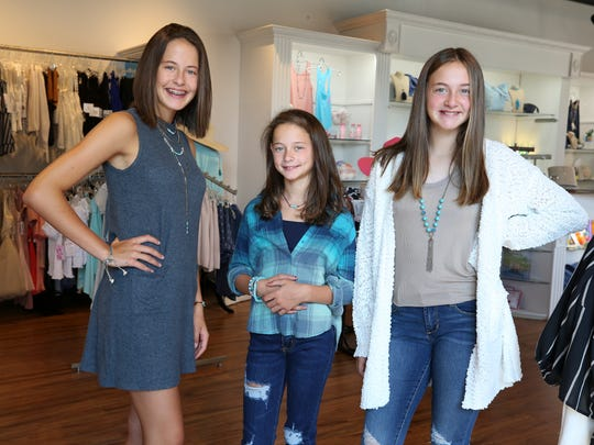 (L-R)  Dylan Breier, 14, along with her sisters Hayden, 9, and Cameron, 12, model the upcoming fashion trends for back to school provided by Fresh Boutique 4 Girls.July 24, 2018