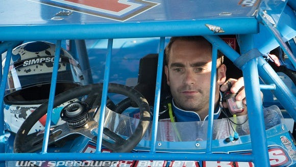 Josh Richards sits in his car, preparing for a World of Outlaws Late Model race last weekend. He now has 73 career wins, which tops the list.